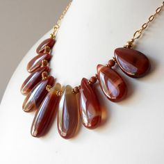 Red+Striped+Agate+Pendant+Necklace+Teardrop+Fan+by+Rocktopolis,+$40.00