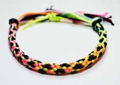This satin corded neon bracelet is perfect for a throwback to the 80s party. or to spruce up a cute beach outfit!