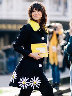 it's just that gorgeous. Mira in Paris. #MiroslavaDuma Pop of color daisies and yellow collar on a beautiful coat.