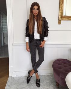 Negin Mirsalehi wears patent black loafers with skinny grey jeans, rolled up for a preppy, retro aesthetic. She wears this with a white button down and a leather jacket. Shoes: Aquatalia.