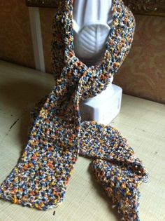 Crocheted scarf made with multi-colored, textured yarn.