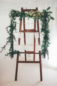 Laddver Foliage Stand Seating Table Chart Whimsical Green White Fairy Lights Winter Wedding http://jesspetrie.com/
