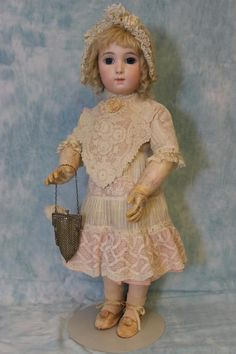 "Antique 24 inch Bebe Jumeau Emile Jumeau Model ""Bebe Triste"" Long Face from turnofthecenturyantiques on Ruby Lane"