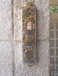 Mezuzah: A parchment inscribed with religious texts and attached in a case to the doorpost of a Jewish house as a sign of faith.