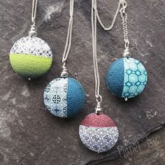 Double sided disc pendants...polymer clay and sterling silver.