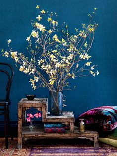 Light flowers against a dark colored wall