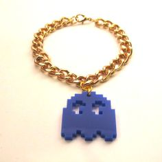 Pac Man style blue laser-cut acrylic Ghost charm, hanging from a chunky gold tone curb chain bracelet.
