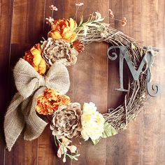 Monogrammed Orange Variety & Burlap Peony Grapevine Wreath with a Striped Burlap Bow.