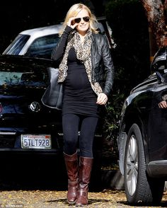 Bad girl: The 34-year-old actress looked rocker chic in a leather jacket and a leopard print scarf