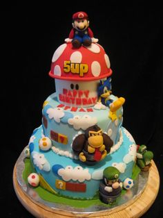 Super Mario Bros cake - 9th birthday cake I recently made. Covered in fondant with gumpaste and fondant sculpted figures.