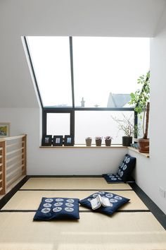 """The tatami room (pictured) has mats from the Futon Company and a """"Hinamatsuri"""" mobile adds a cheery touch."""