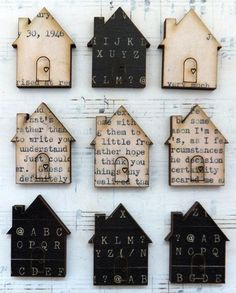 houses die-cut from old book pages, magazines, etc.  (Unfortunately it looks like the website I got this from was redesigned. I can't find the pic or info about it there any more. I've removed the link but you can still go there if you'd like, https://www.artchixstudio.com)