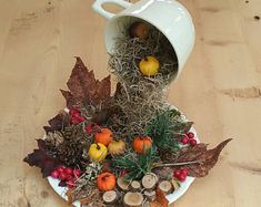 Items similar to Christmas Decor Floating Cup Centerpiece Topiary on Etsy Leaf Crafts, Pine Cone Crafts, Autumn Crafts, Fall Crafts For Kids, Kids Diy, Christmas Centerpieces, Christmas Decorations, Centerpiece Decorations, Floating Tea Cup