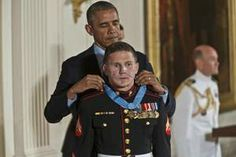 Retired Marine Cpl. William Kyle Carpenter receives the Medal of Honor from President Obama on Thursday at the White House.