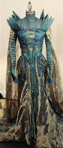 """The Dung Beetle Turquoise Shell Gown of Charlize Theron in Snow White and the Huntsman -- Interview with costume designer Colleen Atwood. """"The three-time Oscar winner literally went wild when she was designing the costumes for Charlize. She created a turquoise and golden chiffon gown to depict the queen's rotting phase. And for a perfect touch of dark drama, the gown was crafted from the shells of dung beetles..."""""""