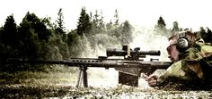 This is a M107 50. cal Barret Sniper Rifle. This was taken immediately after the trigger was pulled. Notice the brass from the round in mid air.