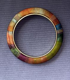 watercolored brass bangles by labeanabags, via Flickr beautiful