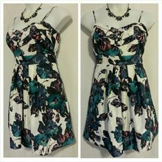 """Sweetheart Neckline Floral Dress Sweetheart Neckline Floral Dress looks good for any occasion. The floral pattern features white, navy, pink, purple, and teal. Dress has adjustable straps, padded bust, back zipper, and sash ties at back. Fully lined. 100% Polyester  Measurements: 35"""" length from top of shoulder strap to hem, 22"""" skirt from waist to hem, 38"""" Bust, 36"""" Waist Charlotte Russe Dresses"""