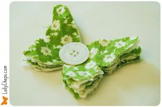 Simple fabric  layered Butterfly with button center.