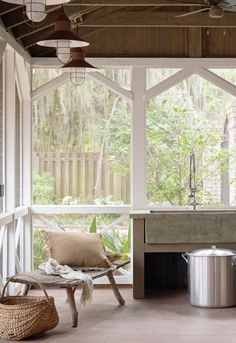 Screened in porch. Love the barnwood rafters, barn lights, and white painted framing. Handy to have a large utility sink for washing up dirty kiddos and outdoor cooking.