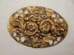 """This is a lovely oval shaped repousse brooch. I believe this to be from the Art Nouveau period.  It is nice size at 3"""" across and 2 inches in width. It is very ornate, with..."""