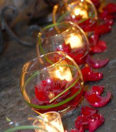 Sprinkling petals around candles and flower-filled votives. Find petals here: www.myonlineweddi...  Photo Credit: studio1923.com