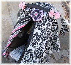 Carseat Canopy with Removable Flower Clip and Bows Girly Damask RTS. $35.99, via Etsy.