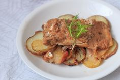 Dressed in spiced apple sauce and cooked to perfection, this roasted salmon rests on a bed of naturally sweet, caramelized apples and potatoes.