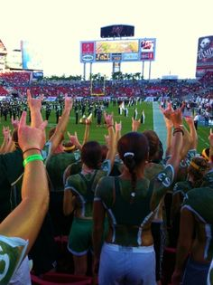 #USF student section with their horns up at a football game.