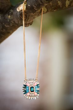 Hang out with this crystal and gold necklace. Blue, pink, and clear - fabulous #7charmingsisters