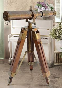 This is an antique brass extendable nautical telescope with wonderful leather case stitched. It has excellent optics for real viewing and would make a wonderful usable nautical decor in any office, boat or home.