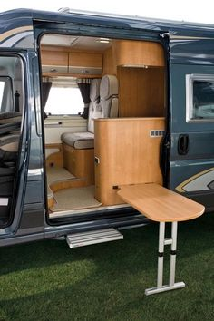Folding exterior side table in a Trigano Tribute camper build on a Fiat Ducato van chassis.