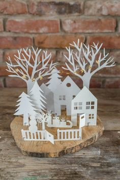 Decoration ideas for Advent: hanging Advent wreath and small Christmas world of paper - Jane™ - Winter Fashion Christmas World, Christmas Villages, Noel Christmas, Christmas Paper, Christmas Ornaments, Christmas Houses, Outdoor Christmas, Natal Diy, Paper Houses
