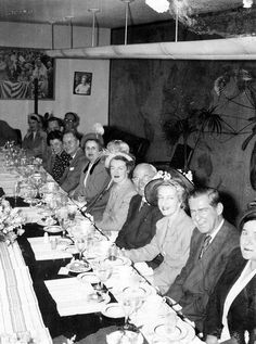 Snapshot of President Harry S. Truman (fourth from the right) at a birthday luncheon, May 1950.