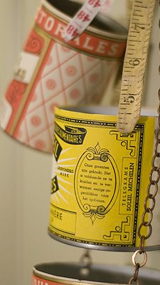printable vintage label glued to food cans made into storage vessels. easy and cute