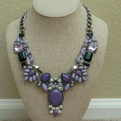 T&J Designs Purple Stone Burst Necklace Calling all purple lovers! This gorgeous necklace will jazz up any outfit, dress or casual. Hematite finish 18k white gold plated with glass crystals. Nickel and lead free.  4 currently available. If this listing is sold, please check my closet.for a duplicate one.  10% off in a bundle! No trades. T&J Designs Jewelry Necklaces