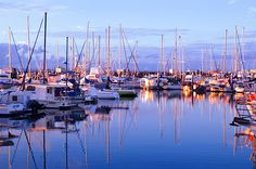 The sunrise and yachts at the Hervey Bay marina in Queensland, Australia