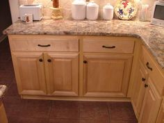 Maple cabinets with wrought iron hardware