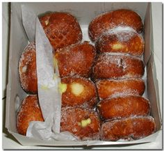 Malasadas ~ Oh yum !!!  These melt in your mouth when they are served warm.