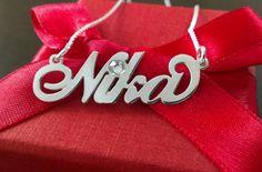 Srebrna verižica z imenom Nika z dodatkom cikron