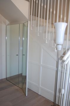 Boiserie and door with mirror ,under stair