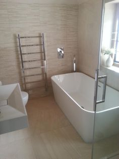 Neutral perfection using VADO's Geo bath spout and Notion shower valve. Stunning bathroom by Premier Contracts, UK. #veryVADO