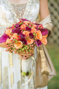 Coral and hot pink bouquet from Carla & Kevin's multicultural, backyard wedding in Northern Virginia