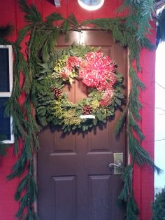 Fresh green roping and Christmas wreath with bow custom created by Stauffers Garden Centers. http://www.skh.com/home-garden/