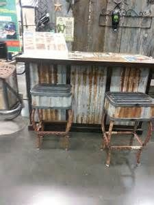 Fence stakes and corrugated metal siding to make bar stools and a bar ...
