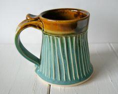 Handmade Mug, Pottery Coffee Mug in Moss Green and Amber by RiverStone Pottery. $28.00, via Etsy.