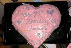 Easy kids heart Birthday cake. Take a square and round cake, cut circle in half use frosting to connect. Viola! My daughter loves it.