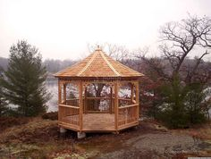 This Cedar Carlisle gazebo plan in Toronto, Ontario with cedar shingles is carefully placed on top of the hill for a lakeside view. Outside Playhouse, Build A Playhouse, Playhouse Outdoor, Wooden Playhouse, Outdoor Rooms, Playhouse Kits, Backyard Gazebo, Lakeside View, Gazebo Plans