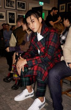 Wearing pieces from the new runway collection, Kris Wu on the Burberry September 2017 front row, for London Fashion Week