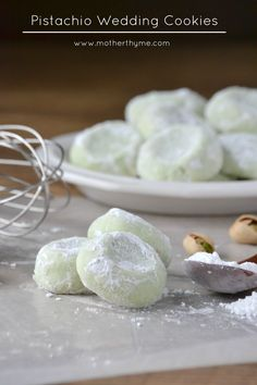 Pistachio Wedding Cookies: • Cream butter. Beat in ½ cup sugar til fluffy. Add vanilla • Combine flour, pudding mix & salt. Mix flour mixture into wet • Divide dough in 1/2 & form into a ball. Wrap in plastic wrap & place in frig for at least an hour • Preheat oven 350. Line baking sheets w parchment • Remove dough from wrap & make tspn balls. Place & press down on balls -space about 1 inch apart • Bake 9-10 mins. Cool about 5 minutes.  • While cookies still warm toss in confectioners & cool
